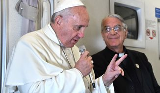 "Pope Francis talked about ""responsible parenthood"" with journalists during his flight from Manila to Rome, Monday, Jan. 19. In a later interview, a cleric clarified that the pontiff's words about not acting like ""rabbits"" were misunderstood by the press; large families are beautiful and valuable. (AP Photo/Giuseppe Cacace, pool)"