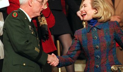 First lady Hillary Rodham Clinton greets Gen. Barry McCaffrey, President Clinton's choice to become the next drug czar, Tuesday Jan. 23, 1996 on Capitol Hill prior to the president's State of the Union address. (AP Photo/Denis Paquin)