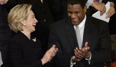 First lady Hillary Rodham Clinton applauds Chicago Cubs rightfielder Sammy Sosa prior to President Clinton's State of the Union address on Capitol Hill Tuesday, Jan. 19, 1999. Sosa was a guest of Mrs. Clinton for the speech. (AP Photo/Doug Mills)