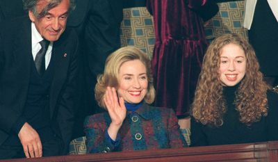 Then-first lady Hillary Rodham Clinton, daughter Chelsea and Nobel Prize winner Elie Wiesel look on as President Clinton arrives in the House Chamber on Capitol Hill Tuesday Jan. 23, 1996, to deliver his State of the Union address. (AP Photo/Greg Gibson) ** FILE **