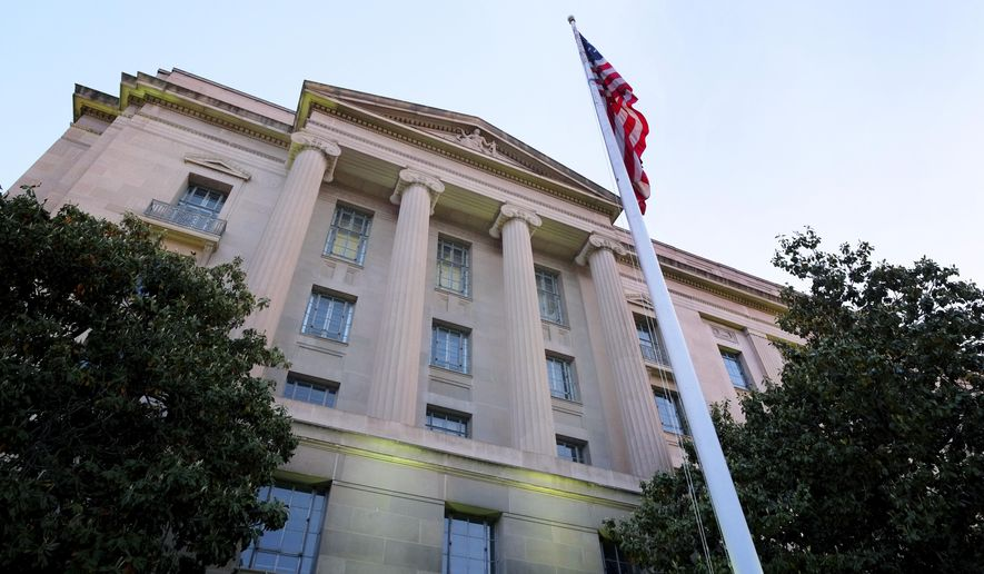 The Department of Justice headquarters building in Washington is seen here on May 14, 2013. (Associated Press) **FILE**
