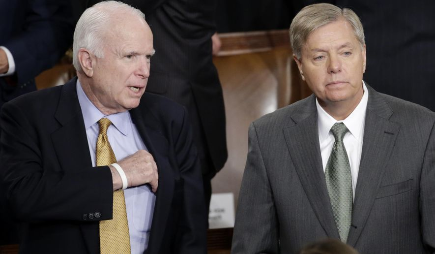 Sen. John McCain, R-Ariz., left, talks with Sen.Lindsey Graham, R-S.C., on Capitol Hill in Washington, Tuesday, Jan. 20, 2015, before President Barack Obama's State of the Union address before a joint session of Congress. (AP Photo/Pablo Martinez Monsivais)