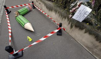 """An anonymous art installation showing a broken pencil is displayed on the pavement near the Charlie Hebdo office in Paris, Tuesday, Jan. 20, 2015. Terror attacks by French Islamic extremists should force the country to look inward at its """"ethnic apartheid,"""" the prime minister said Tuesday as four men faced preliminary charges on suspicion of links to one of the gunmen. (AP Photo/Francois Mori)"""