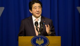 "Japan's Prime Minister Shinzo Abe speaks during a press conference in Jerusalem, Tuesday, Jan. 20, 2015. The Islamic State group threatened to kill two Japanese hostages Tuesday unless they receive $200 million in 72 hours, directly demanding the ransom from Japan's premier during his visit to the Middle East. Abe vowed to save the men, saying: ""Their lives are the top priority."" (AP Photo/Sebastian Scheiner)"