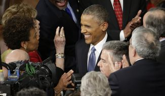 President Barack Obama is greeted on  Capitol Hill in Washington, Tuesday, Jan. 20, 2015, before his State of the Union address before a joint session of Congress. (AP Photo/Pablo Martinez Monsivais)