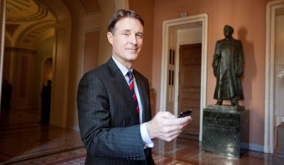 Former Sen. Evan Bayh of Indiana unveiled a report countering that staffers for Sen. Dianne Feinstein, California Democrat, were hacked by the CIA. Rather, he says, Ms. Feinstein's staff left CIA premises with documents without permission. (Associated Press)