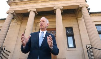 Wisconsin Republican Sen. Ron Johnson speaks on the steps of Wisconsin Eastern District Federal Courthouse in Green Bay, Wis., in this July 7, 2014, file photo. (AP Photo/The Green Bay Press-Gazette, Jim Matthews, File) NO SALES