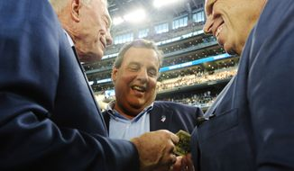 CORRECTS ID FROM JOHN MARA TO STEVE TISCH - Dallas Cowboys owner Jerry Jones, left, New Jersey Gov. Chris Christie and New York Giants executive vice-President Steve Tisch, right, talk before an NFL football game between the Giants and Cowboys, Sunday, Sept. 8, 2013, in Arlington, Texas. (AP Photo/LM Otero)