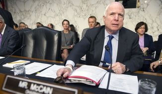 Senate Armed Services Committee Chairman Sen. John McCain, R-Ariz., bangs the gavel to start the committee's hearing to examine global challenges and U.S. national security strategy, Wednesday, Jan. 21, 2015, on Capitol Hill in Washington. (AP Photo/Cliff Owen)