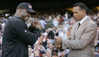 FILE - In this July 9, 2007, file photo, American League's Alex Rodriguez, right, of the New York Yankees, compares grips with National League's Barry Bonds, of the San Francisco Giants, during the All-Star Home Run Baseball Derby in San Francisco. Rodriguez is getting hitting tips from Bonds as the Yankees third baseman prepares to return from a season-long suspension. Rodriguez spokesman Ron Berkowitz confirmed the workouts, which the San Francisco Chronicle reported Wednesday, Jan. 21, 2015, took place at the Future Prospects batting cages in San Rafael, Calif. (AP Photo/Jeff Chiu, File)