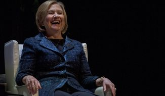 Former U.S. Secretary of State Hillary Rodham Clinton laughs after people questioned about a presidential run while she speaks to a crowd in Saskatoon, Saskatchewan, on Wednesday, Jan. 21, 2015. (AP Photo/The Canadian Press, Liam Richards)