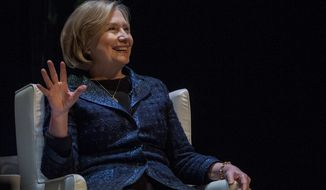 Former U.S. Secretary of State Hillary Rodham Clinton laughs after people questioned about a Presidential run while she speaks to a crowd in Saskatoon, Saskatchewan on Wednesday, Jan. 21, 2015. (AP Photo/The Canadian Press, Liam Richards)
