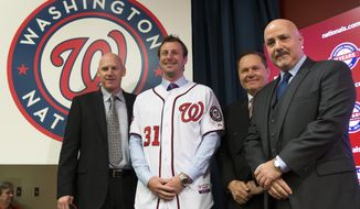 Washington Nationals pitcher Max Scherzer, second from left, poses for photographs during an introductory news conference at Nationals Park, on Wednesday, Jan. 21, 2015, in Washington. Scherzer signed a $210 million, seven- year contract to join the Nationals. From left, Nationals manager Matt Williams, Scherzer, Scherzer's agent Scott Boras, and Nationals general manager Mike Rizzo. (AP Photo/Evan Vucci)