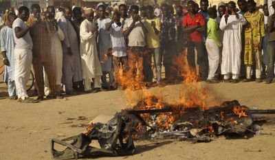 Boko Haram terrorists, who have left devastation in parts of Nigeria (pictured), are bringing their mayhem into Niger, says a Catholic missionary, who is in hiding but sent an email to a Catholic charity.