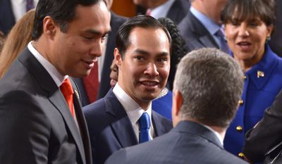 Member of the US House of Representatives from Texas's 20th district Joaquin Castro (L) and twin brother US Secretary of Housing and Urban Development Julian Castro (C) chat following US President Barack Obama's State Of The Union address on January 20, 2015 at the US Capitol in Washington, DC. AFP PHOTO/POOL/MANDEL NGAN