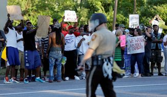 Many police departments are saying it is a mistake to agree to the states setting up independent review boards to evaluate police misconduct, such as the case of the shooting death of Michael Brown in Ferguson, Missouri, last summer. (Associated Press)