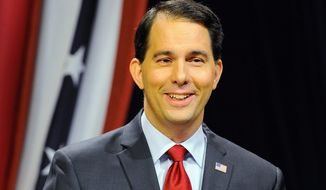 Wisconsin Republican Governor Scott Walker is one of 23 potential GOP presidential hopefuls heading to the Iowa Freedom Summit in Des Moines on Saturday to test their messages.  (Associated Press)