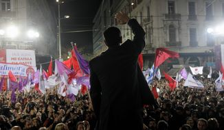 Alexis Tsipras, leader of Greece's Syriza left-wing main opposition party, waves to his supporters as he arrives for a pre-election speech at Omonia Square in Athens Thursday. Prime Minister Antonis Samaras' New Democracy party has failed so far to overcome a gap in opinion polls with the anti-bailout Syriza party ahead of the Jan. 25 general election. (Associated Press)