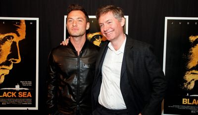 """Jude Law (left) joined director Kevin Macdonald for the premiere of the submarine thriller """"Black Sea"""" on Wednesday. (Associated Press)"""