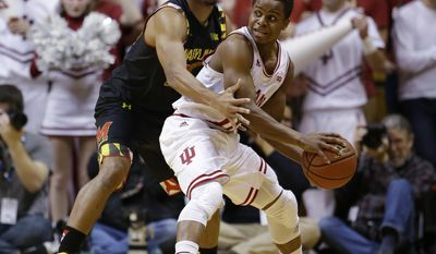 Maryland guard Richaud Pack (20), left, tries to trap Indiana guard Yogi Ferrell (11) in the first half of an NCAA college basketball game in Bloomington, Ind., Thursday, Jan. 22, 2015. (AP Photo/Michael Conroy)