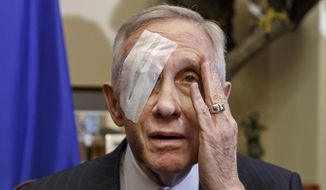 Senate Minority Leader Harry Reid of Nev., 75, talks to reporters on Capitol Hill in Washington, Thursday, Jan. 22, 2015, for the first time since he suffered an eye injury and broken ribs on New Year's Day, when a piece of exercise equipment he was using broke and sent him smashing into cabinets at his new home. Reid sais his re-election bid in 2016 is on track even though he's been sidelined by an exercise accident. (AP Photo/J. Scott Applewhite)