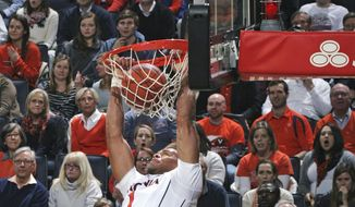 Virginia guard Justin Anderson (1) dunks in front of Georgia Tech guard Tadric Jackson (1) during an NCAA college basketball game Thursday, Jan. 22, 2015, in Charlottesville, Va. (AP Photo/Andrew Shurtleff)