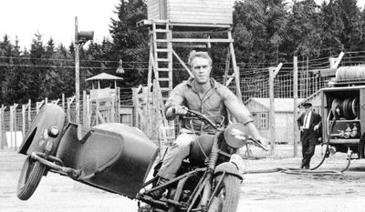 "Steve McQueen enjoys rehearsal of his escape scene in the film ""The Great Escape,†being filmed in Munich, Germany on Jan. 1, 1963. McQueen, who feels at home on a motorcycle, rode the dangerous course without benefit of a stuntman or stand-in. McQueen earned $9 million last year, thanks in part to Porsche who used the actor's image with a new line of McQueen clothes including a $500 racing jacket. (AP Photo)"