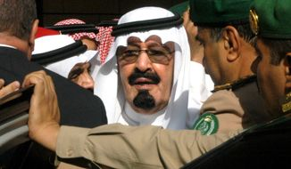 FILE - In this Tuesday, Aug. 2, 2005 file photo, Saudi Arabia's new King Abdullah leaves after special prayers for late King Fahd at Riyadh, Saudi Arabia's Turk bin Abdullah mosque. On early Friday, Jan. 23, 2015, Saudi state TV reported King Abdullah died at the age of 90. (AP Photo)