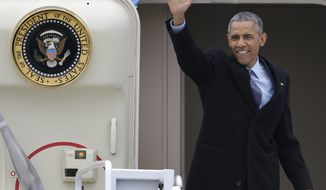 President Barack Obama waves as he boards Air Force One at Forbes Field in Topeka, Kansas, Thursday, Jan. 22, 2015, for a trip to Washington. (AP Photo/Orlin Wagner)