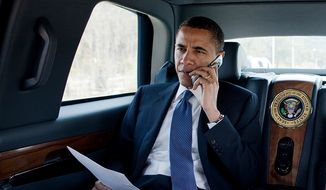President Barack Obama talks on the phone with a Member of Congress while en route to a health care event at George Mason University in Fairfax, Va., March 19, 2010. Assistant to the President for Legislative Affairs Phil Schiliro rides with the President.  (Official White House Photo by Pete Souza)