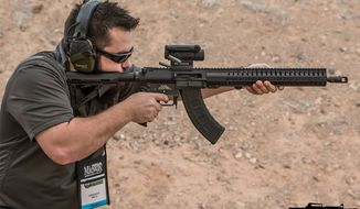 """A man fires the Mk-47 """"Mutant"""" at the annual SHOT Show in Las Vegas, Nev. (Image: Facebook, CMMG Inc.)"""