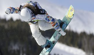 Chloe Kim competes during the women's snowboarding superpipe final at the Dew Tour iON Mountain Championships in Breckenridge, Colo.  (AP Photo/Julie Jacobson, File)