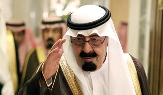 File - In this Tuesday, May 11, 2010 file photo, Saudi King Abdullah bin Abd al-Aziz, salutes as he arrives to the opening of the Gulf Cooperation Council (GCC) consultative summit in Riyadh, Saudi Arabia. On early Friday, Jan. 23, 2015, Saudi state TV reported King Abdullah died at the age of 90. (AP Photo/Hassan Ammar, File)