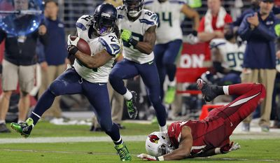 FILE - In this Sunday, Dec. 21, 2014, file photo, Seattle Seahawks running back Marshawn Lynch (24) breaks free from Arizona Cardinals outside linebacker Alex Okafor for a touchdown run during the second half of an NFL football game in Glendale, Ariz. No more Skittles, no more Beast Mode and no more avoiding the media. Is it possible that Lynch will retire after the Super Bowl? (AP Photo/Rick Scuteri, File)