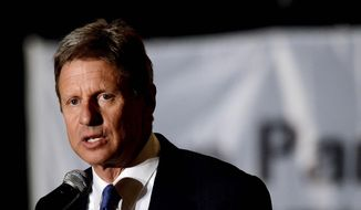 Gary Johnson, who ran for the White house in 2012 as the Libertarian Party candidate, now leads a national movement to allow third-party candidates in national presidential debates. (Associated Press) ** FILE **