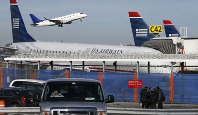 A plane takes off from LaGuardia Airport in New York, Wednesday, Jan. 21, 2015. (Associated Press) ** FILE **