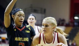 Indiana's Tyra Buss (3) goes to the basket against Maryland's Brene Moseley (3) during the second half of an NCAA college basketball game Sunday, Jan. 25, 2015, in Bloomington, Ind. Maryland won 84-74. (AP Photo/Darron Cummings)