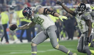 Houston Texans' J.J. Watt (99) celebrates after recovering a fumble during the second half of the NFL Football Pro Bowl Sunday, Jan. 25, 2015, in Glendale, Ariz. (AP Photo/David J. Phillip)