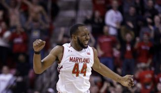 Maryland guard/forward Dez Wells reacts after making the go-ahead shot in the final moments of an NCAA college basketball game against Northwestern, Sunday, Jan. 25, 2015, in College Park, Md. Maryland won 68-67. (AP Photo/Patrick Semansky)