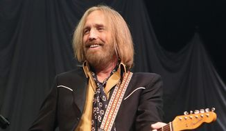 Tom Petty performs in concert with Tom Petty and the Heartbreakers during their Hypnotic Eye Tour 2014 in Philadelphia. (Photo by Owen Sweeney/Invision/AP, File)