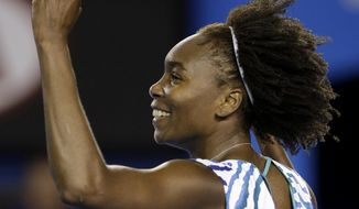 Venus Williams of the U.S. celebrates after winning over Agnieszka Radwanska of Poland in their fourth round match at the Australian Open tennis championship in Melbourne, Australia, Monday, Jan. 26, 2015. (AP Photo/Lee Jin-man)