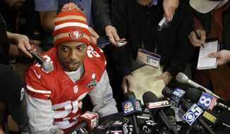 FILE - In this, Jan. 31, 2013, file photo, San Francisco 49ers cornerback Chris Culliver answers questions in New Orleans regarding anti-gay remarks he made during Super Bowl media day. The history of Super Bowl Media Day, and mandatory player availability, has played a key role in making the Super Bowl most-watched NFL TV program. (AP Photo/Mark Humphrey, File)