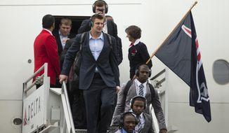 New England Patriots Rob Gronkowski, center, deplanes with teammates after arriving at Phoenix Sky Harbor Airport, Monday, Jan. 26, 2015. The Patriots will play the Seattle Seahawks, Sunday, Feb. 1, 2015, in the NFL Super Bowl XLIX football game in Glendale, Ariz. (AP Photo/The Arizona Republic, Michael Chow)  MARICOPA COUNTY OUT; MAGS OUT; NO SALES