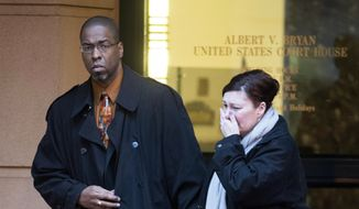 Former CIA officer Jeffrey Sterling leaves the Alexandria Federal Courthouse on Monday in Alexandria, Va., with his wife, Holly, after being convicted on all nine counts he faced of leaking classified details of an operation to thwart Iran's nuclear ambitions to a New York Times reporter. (Associated Press)
