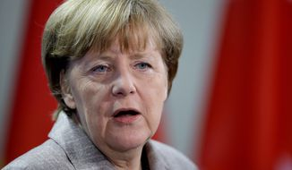 "German Chancellor Angela Merkel said during a visit to Hungary on Monday that her nation will not provide military hardware to Ukraine and asserted that the war with Russia-backed forces ""cannot be solved militarily."" (Associated Press)"