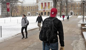 Students walk on Bascom Hill at the University of Wisconsin-Madison between classes in Madison, Wis., Tuesday, Jan. 27, 2015. (AP Photo/Wisconsin State Journal, M.P. King) ** FILE **