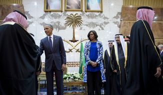 President Barack Obama and first lady Michelle Obama participate in a delegation receiving line with the new Saudi Arabian King, Salman bin Abdul Aziz, in Riyadh, Saudi Arabia, Tuesday, Jan. 27, 2015. The president and first lady have come to express their condolences on the death of the late Saudi Arabian King Abdullah bin Abdulaziz al-Saud. (AP Photo/Carolyn Kaster)