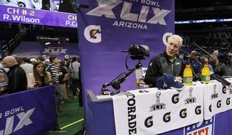 Seattle Seahawks head coach Pete Carroll answers questions during media day for NFL Super Bowl XLIX football game Tuesday, Jan. 27, 2015, in Phoenix. (AP Photo/Matt York)