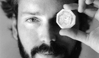 FILE -In this November 1989 file photo, Tommy Thompson holds a $50 pioneer gold piece retrieved earlier in 1989 from the wreck of the gold ship Central America. According to the US Marshals Service,  Thompson, a fugitive treasure hunter wanted for more than 2 years was arrested in Florida. (AP Photo/The Columbus Dispatch, Lon Horwedel)