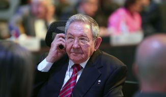 In this publicly distributed handout photo provided by the Presidency of the Republic of Costa Rica, Cuba's President Raul Castro listens on a headphone during the summit of the Community of Latin American and Caribbean States in San Antonio de Belen, Costa Rica, Wednesday, Jan. 28, 2015. (AP Photo/Presidency of the Republic of Costa Rica, Roberto Carlos Sanchez)